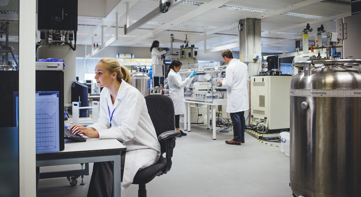Group of medical science professionals working in a laboratory.
