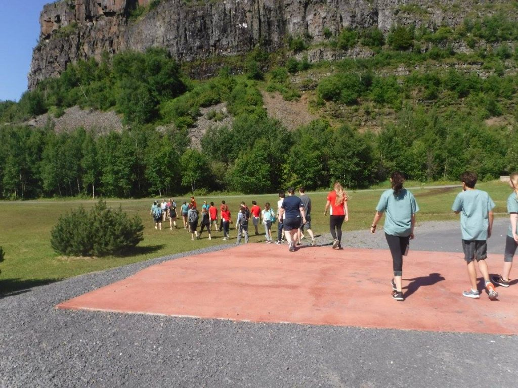 Campers walking outside towards Mount McKay