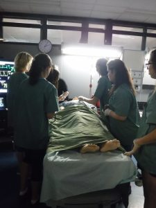 Campers observing SimMan 3G mannequin vital signs monitor