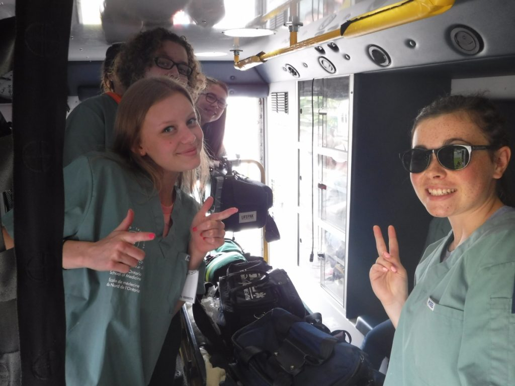 Campers posing inside the ambulance
