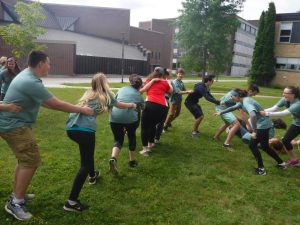 Campers and team leads running around while in a conga line