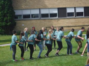 Campers form a conga line outside
