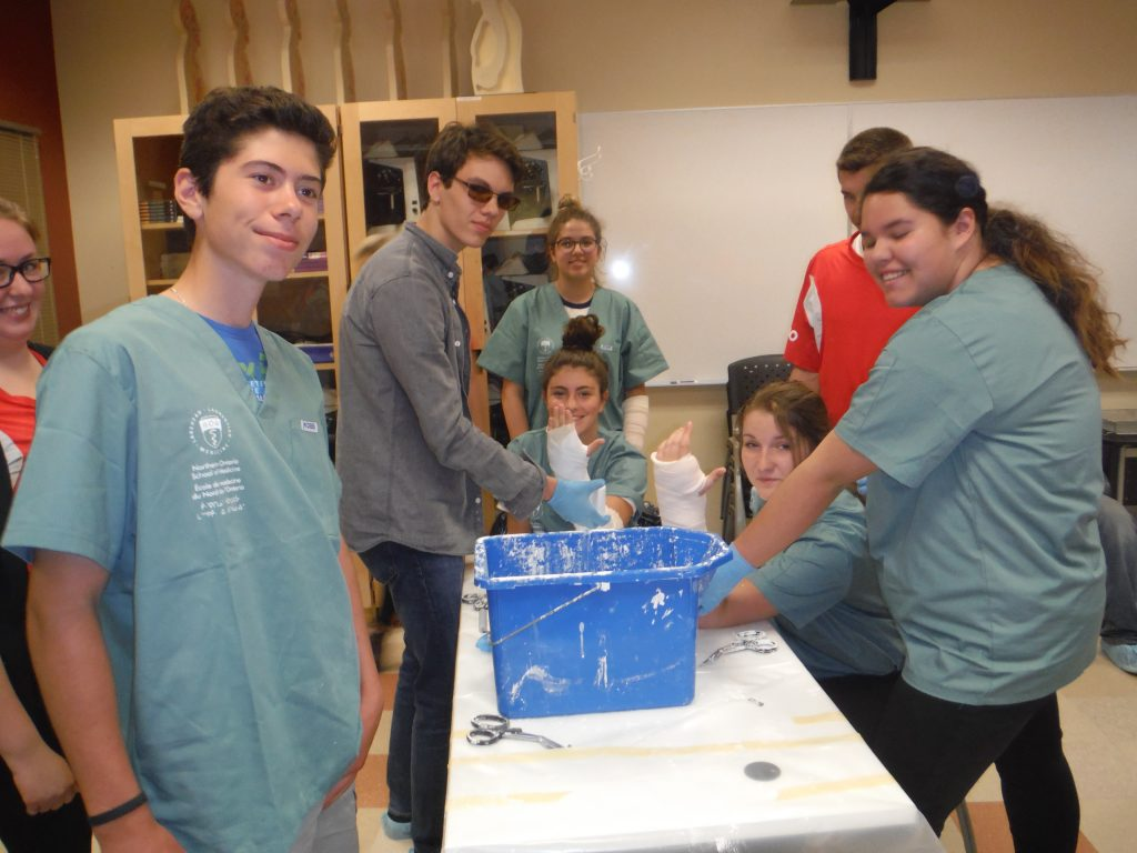Campers pose for photo while completing casting activity