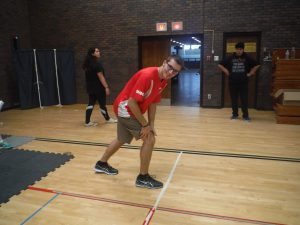 Team lead prepares to run in gymnasium during kinesiology activity