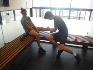 Camper practices proper wrapping technique on fellow campers ankle