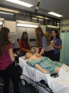 Campers practice CPR on SimMan 3G mannequin in simulation lab