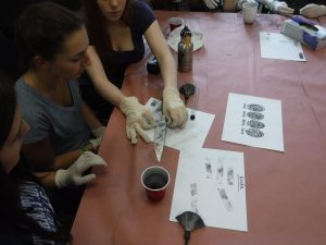 Campers work on fingerprinting analysis