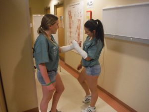 Two campers compare arm casts in lab