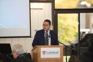 Don Rusnak, Member of Parliment, Thunder Bay-Rainy River, at podium