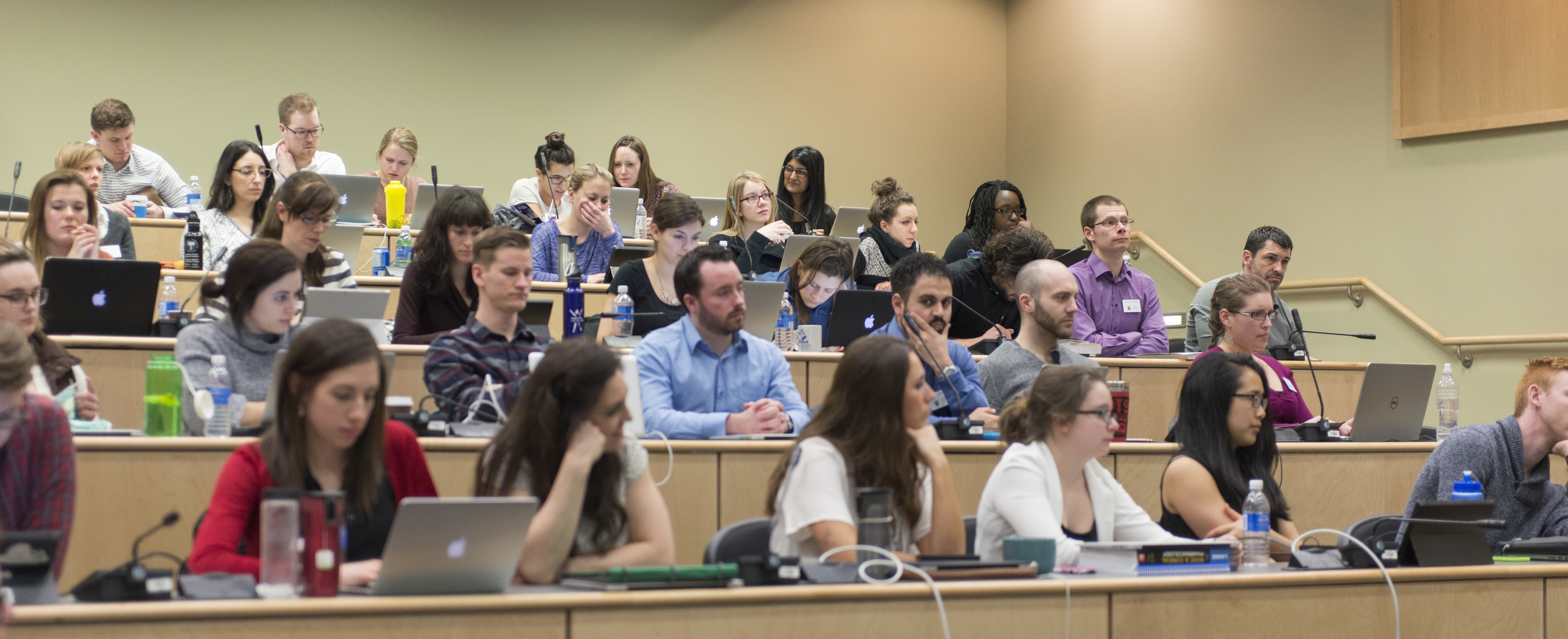 Photo of medical students sitting in lecture style classroom