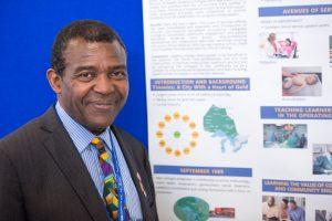 Dr. Emmanuel Abara with poster presentation