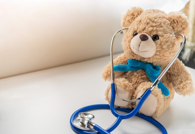 Children doctor concept - Teddy Bear with stethoscope